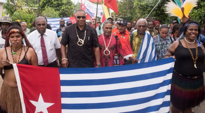 A jubilant crowd marches to the historic Crow's Nest on a summit topping Port Vila, the new home of the United Liberation Movement for West Papua. Dan McGarry