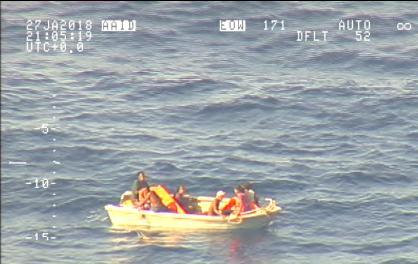 A handout photo supplied by the New Zealand Defence Force shows survivors from a ferry that sunk floating in a boat in the sea near the South Pacific nation of Kiribati, January 27, 2018. Picture taken January 27, 2018. New Zealand Defence Force/Handout via REUTERS