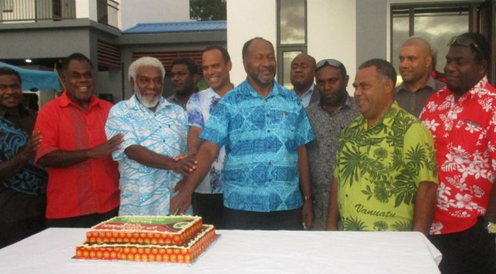 The Prime Minister and government ministers cut a cake to mark their two years in government.