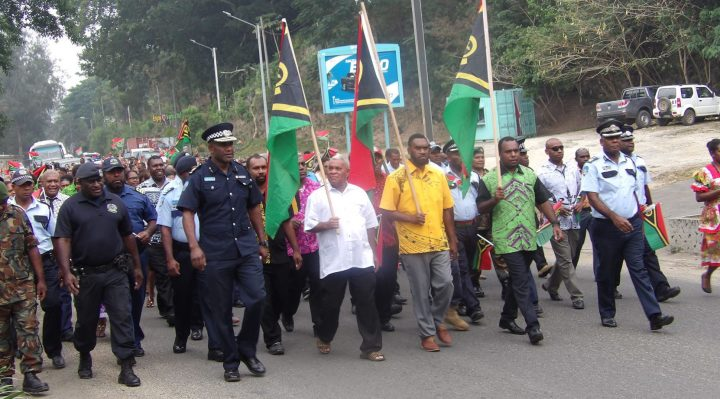 Left to right: Commissioner of Police Albert Nalpini, Deputy Prime Minister Bob Loughman, Mayor Albert Sandy Daniel and Minister of Internal Affairs Andrew Napuat each with national flag in Victory Parade at Fatumaru Bay