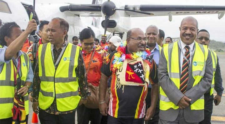 From left: Indonesian ambassador to PNG, His Excellency Ronald Manik, Governor Enembe, Governor Parkop and others walking out of the tarmac at Jackson's International Airport in Port Moresby. Photo: Wanpis Ako