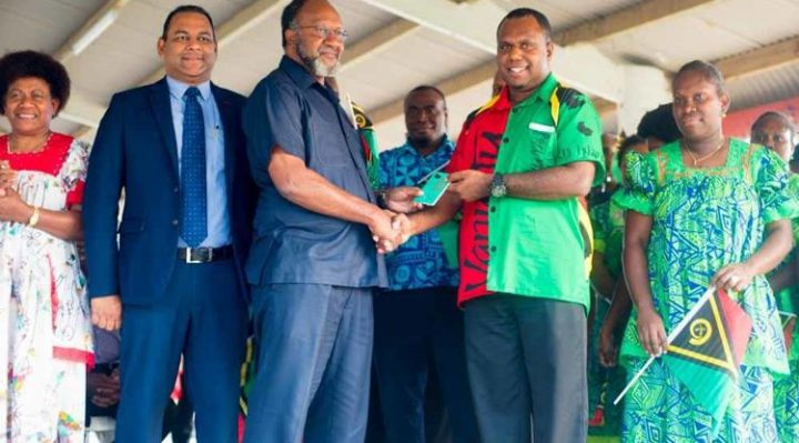 Minister Napuat and staff of the Vanuatu Immigration Services presenting PM Salwai with his new passport to mark yesterday's launching. Photo: Adorina Massing. By Anita Roberts