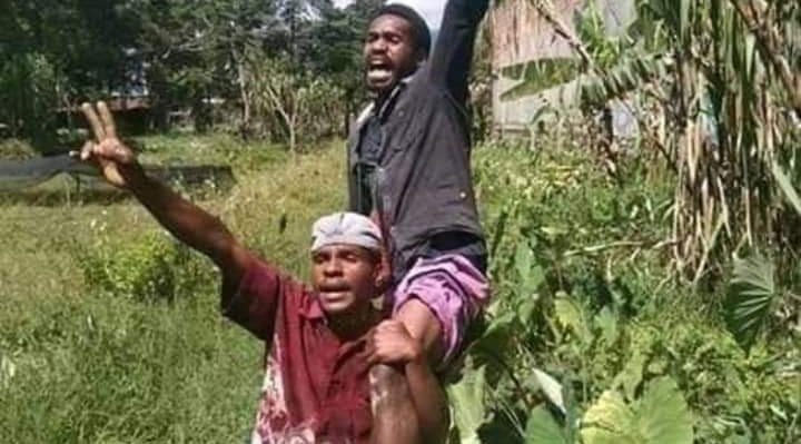 Two Melanesian Students in Wamena after being shot by Indonesian army declaring independence