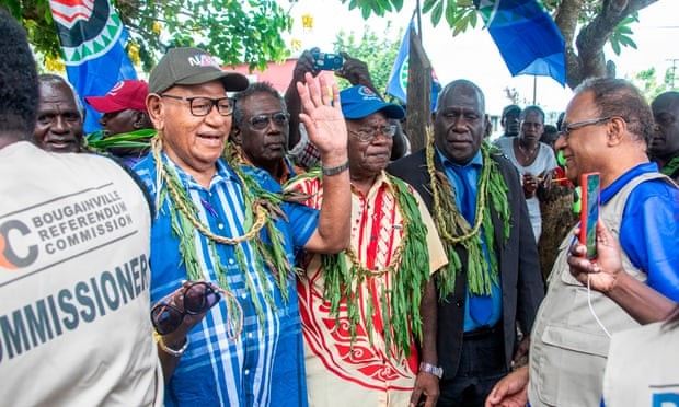 Bougainville regional president John Momis waves as he arrives at a polling station in Buka on Saturday. Photograph: Ness Kerton/AFP via Getty Images