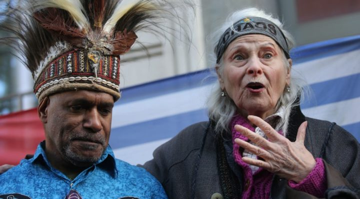 British designer Vivienne Westwood, (R), gestures with West Papua activist Benny Wenda (L) during a protest action to highlight the exploitation of the West Papua rainforest and the continued presence of BP in the area, outside the headquarters of BP in London, on October 18, 2019 (AFP via Getty Images)